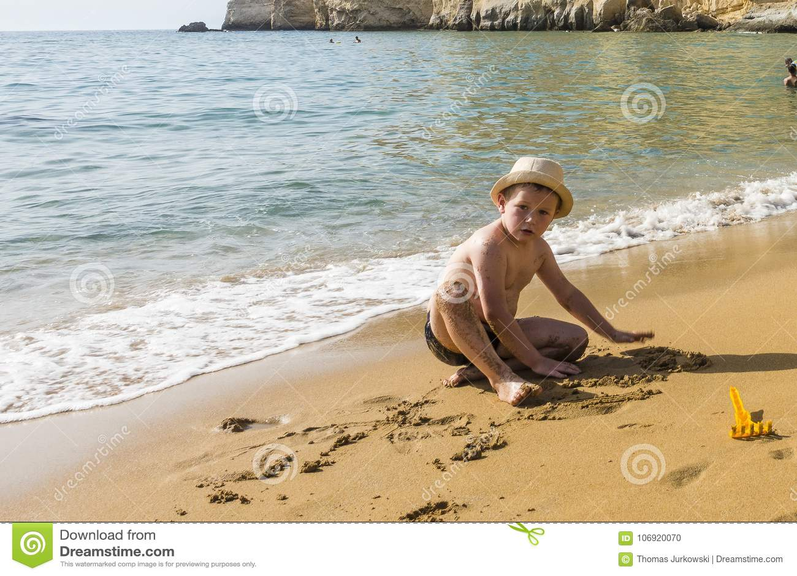 Young boy nudists beach