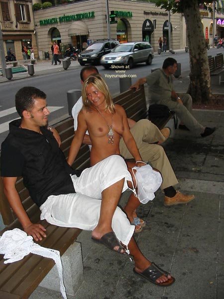 Naked girls on park benches