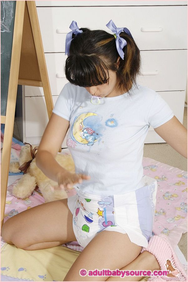 Adult in nappies playing