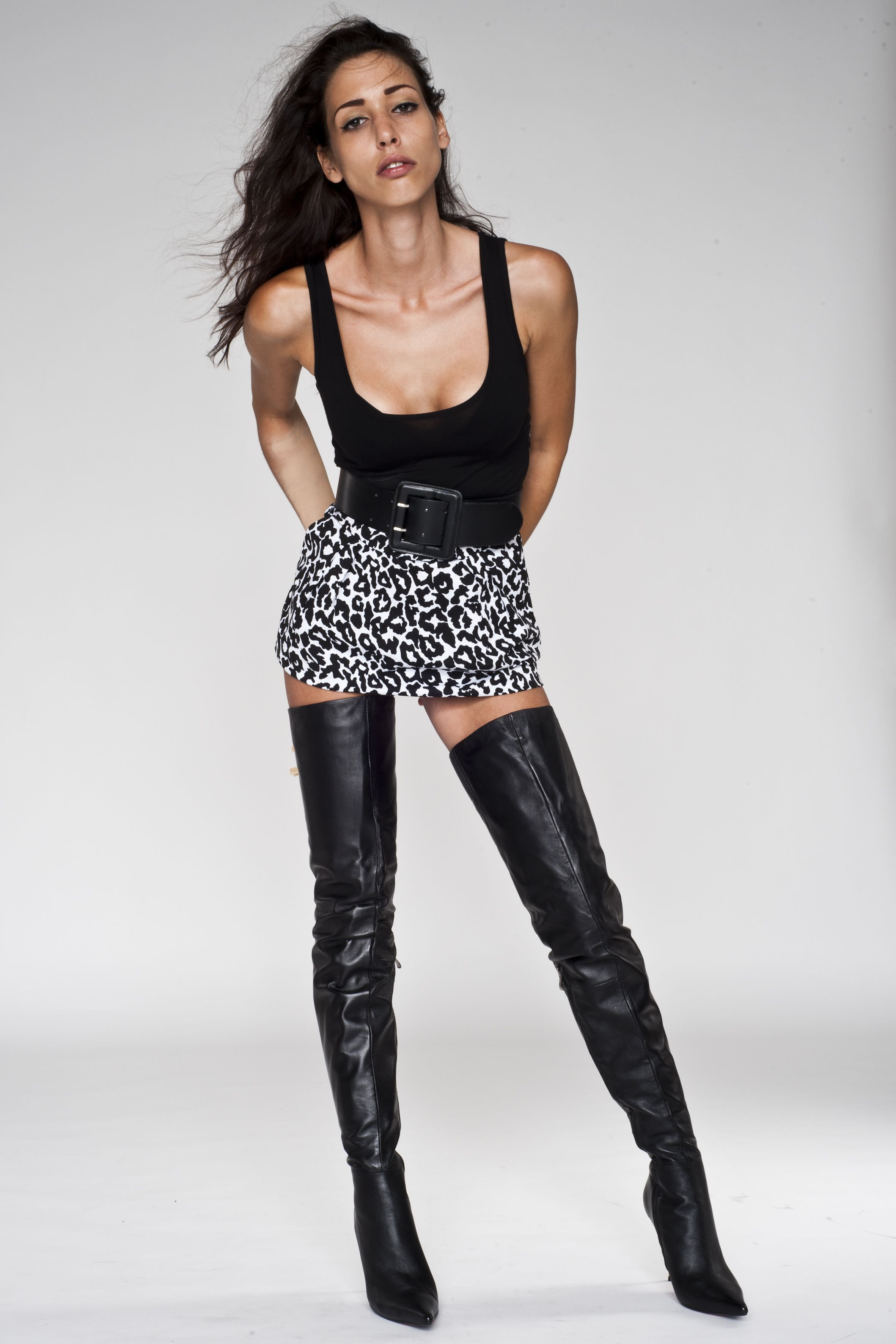 Woman in black leather boots