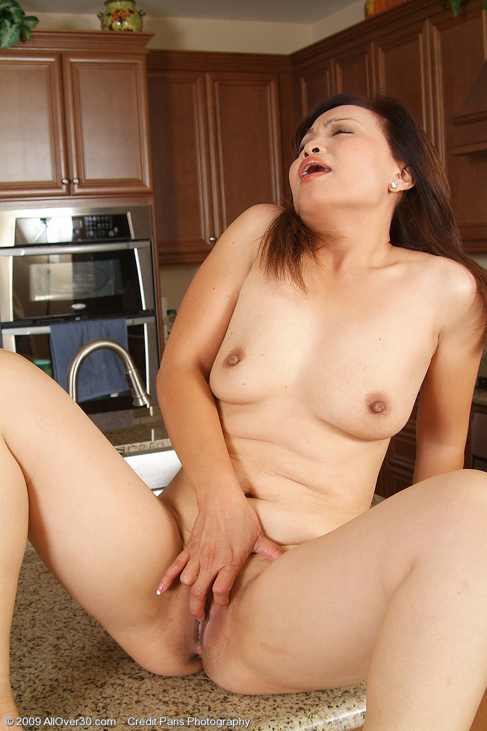 Mature asian woman masturbating