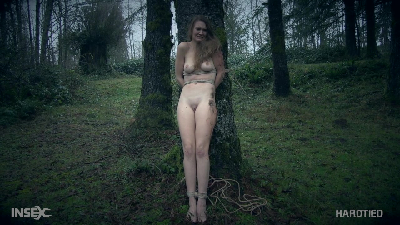 Woman topless in forest