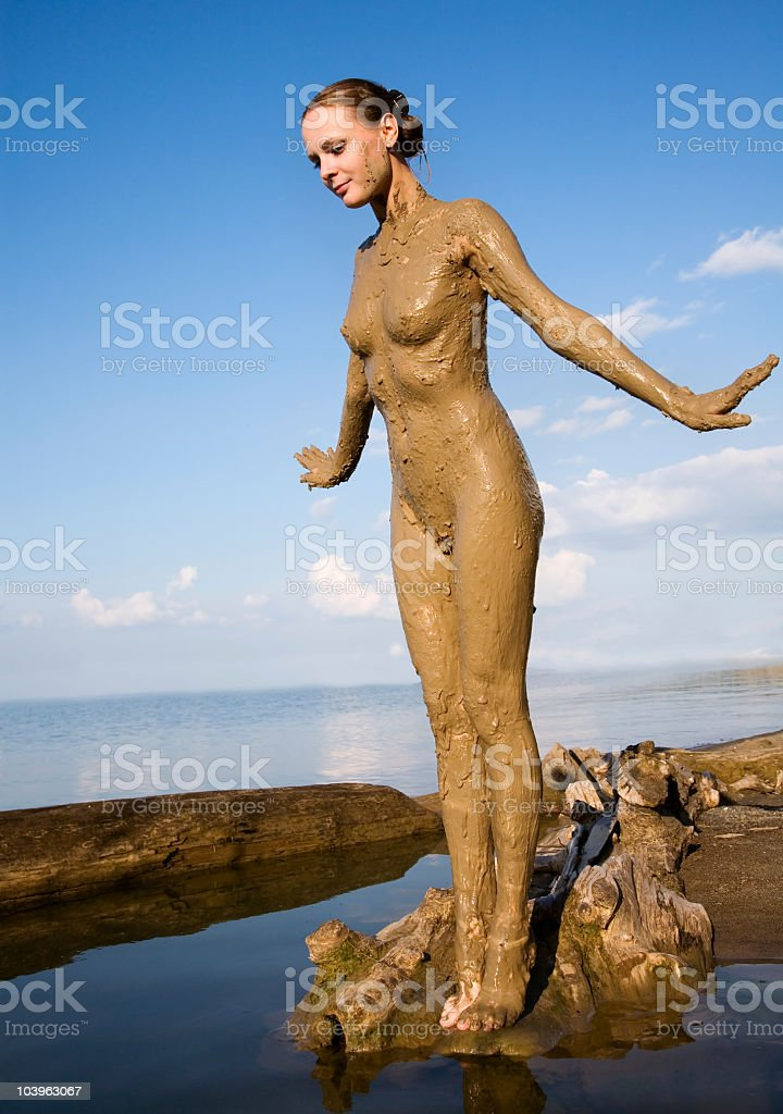 Naked girl in mud