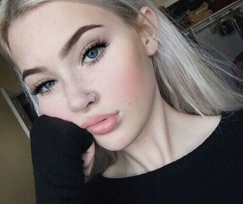 Cute girl with nose piercing