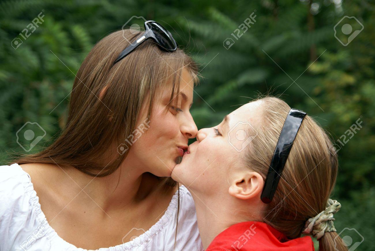 Teen girls kissing at a water park