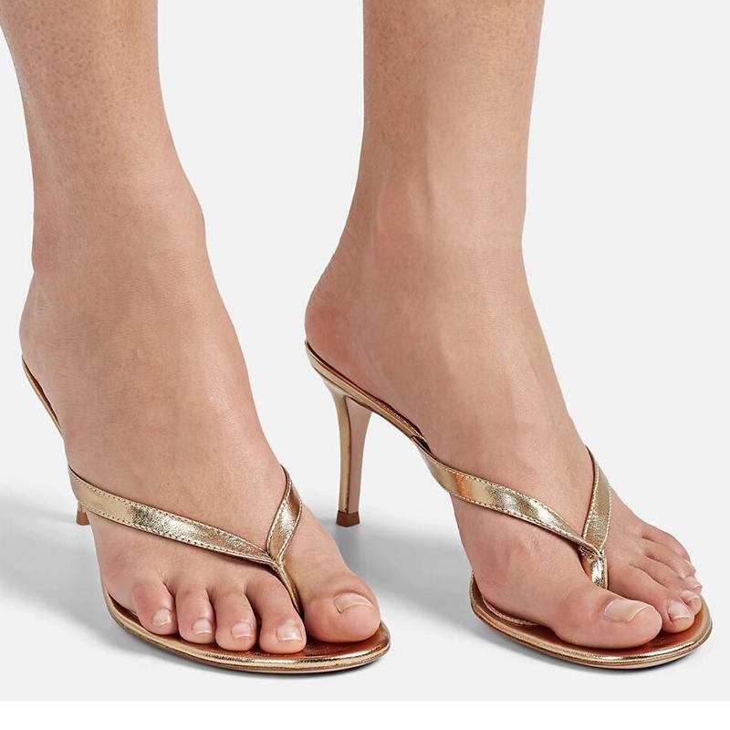 Feet in high heels thong sandals