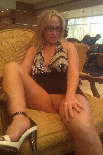 Blonde milf flashing in public