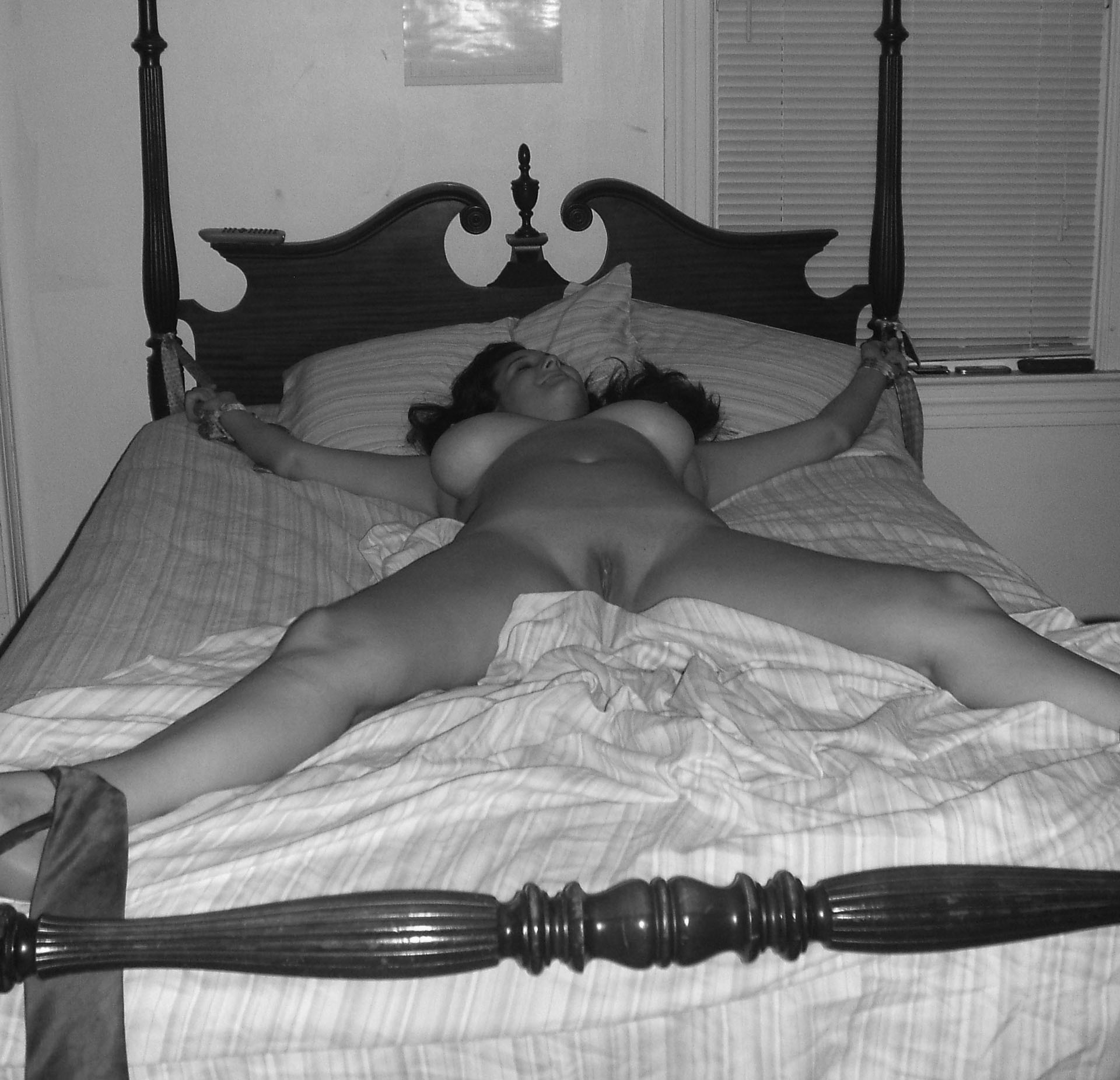 Naked women tied to beds