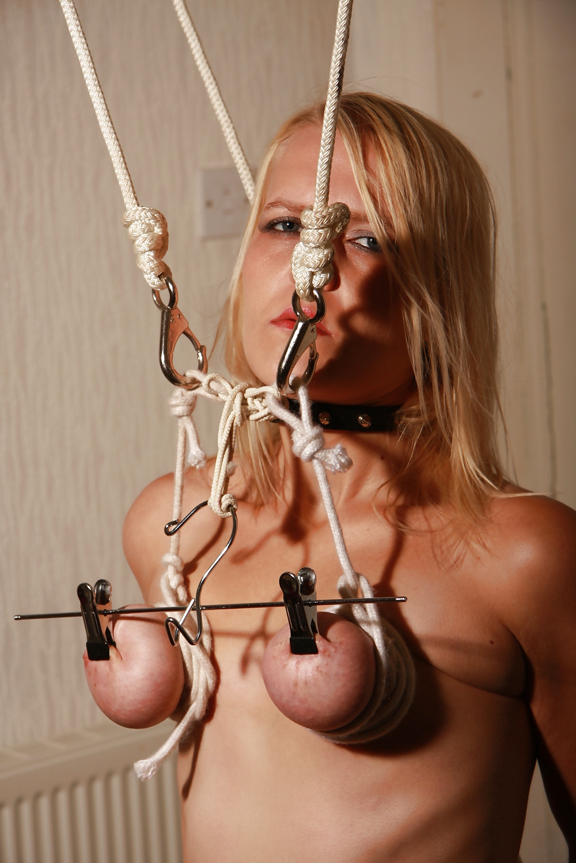 Pulled nipple clothes hanger bdsm