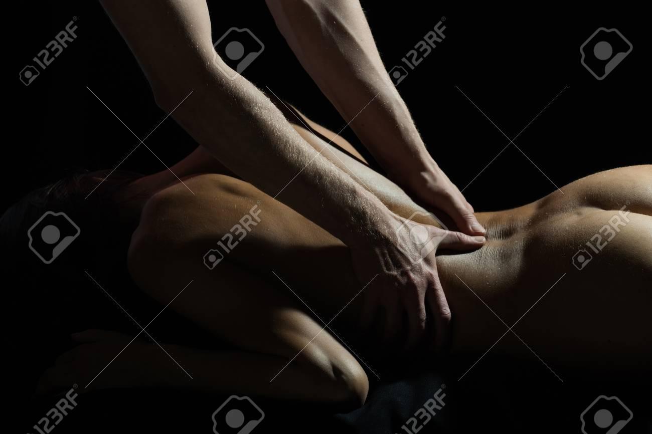 Man and woman erotic massage