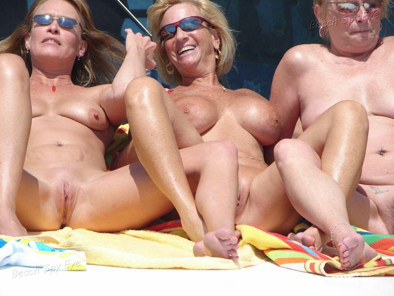 Nude women on a beach, close up