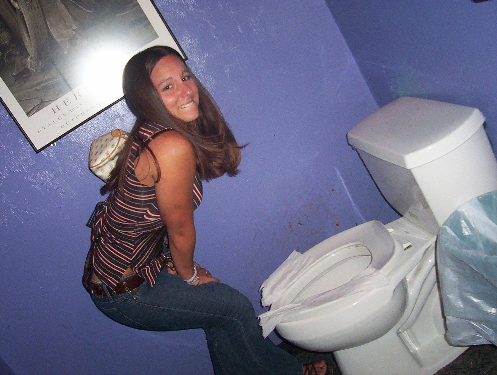 Toilet desperation peeing her pants