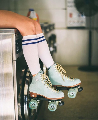 Girls in socks and roller skates