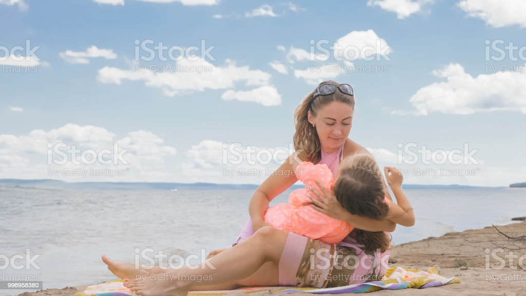 Young cute girls at beach