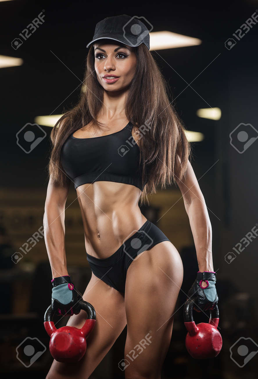 Athletic girls with six pack abs