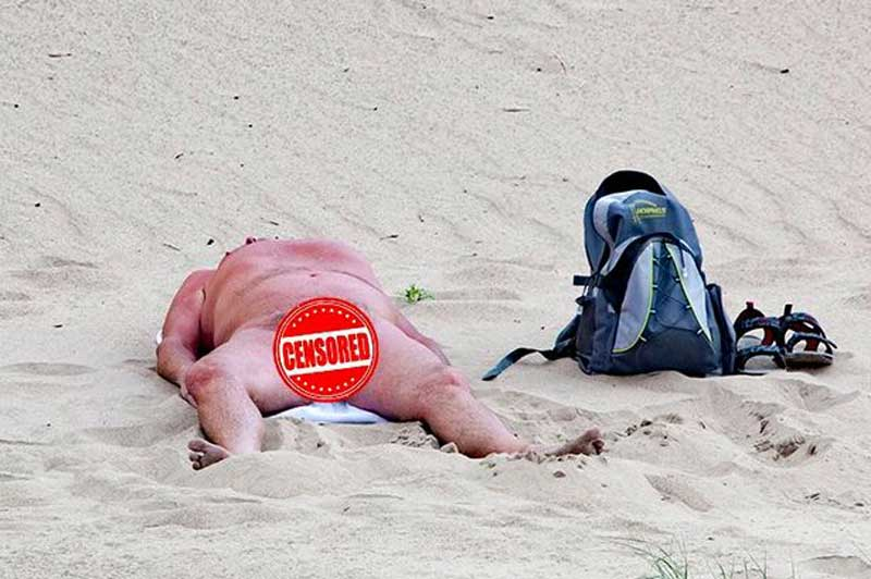 Family nudists on the beach